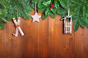 Fir branches and  Christmas decorations on wooden boards