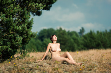 Naked woman sunbathing