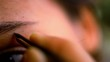 Постер, плакат: Part of face woman plucking eyebrows depilating with tweezers