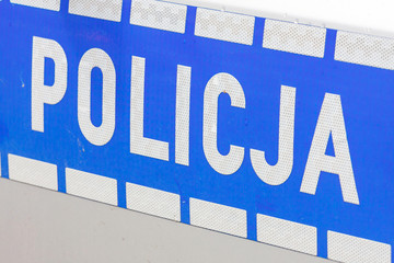 Polish police sign on a door of police car