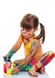 canvas print picture - little girl painting with paintbrush and colorful paints