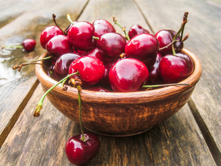 Wet cherries in an earthenware bowl