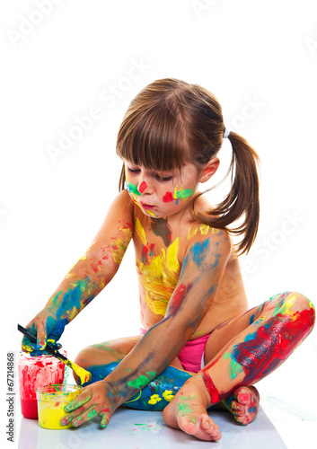 canvas print picture little girl painting with paintbrush and colorful paints