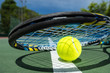 canvas print picture - view of tennis racket and balls on the clay tennis court