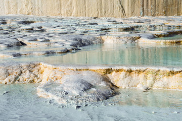 Carbonate travertines with blue water, Pamukkale, Turkey