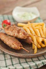 Cevapcici with tzatziki. The traditional Balkan dish