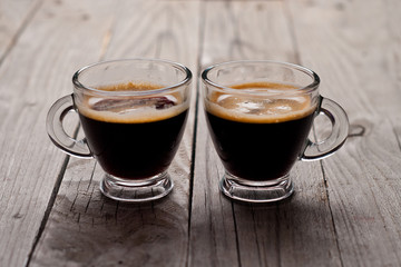 Closeup of two small cups with espresso.