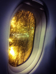 Looking trough an airplane Window in a rainy night