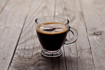 Closeup of  small cup with espresso.