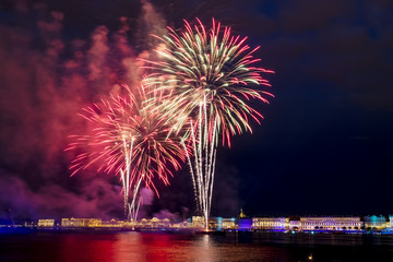The fireworks and a laser show in the waters of the Neva River i