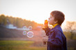 Boy with soap bubbles - 67217037