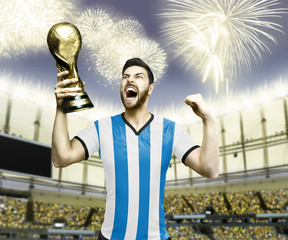 Argentinian soccer player celebrates the victory after the match