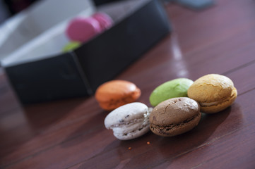 French colorful macarons on a wooden floor, morning snack