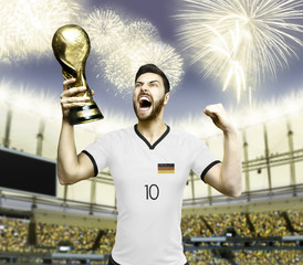 German soccer player celebrates the victory in the stadium