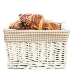 Delicious croissants in the basket