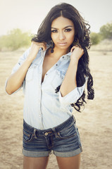 Beautiful exotic young woman wearing denim