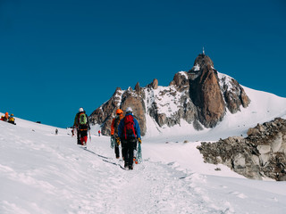 The Aiguille du Midi peak; in foreground a group of mountaineers
