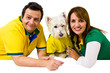 Brazilian couple and pet supporters