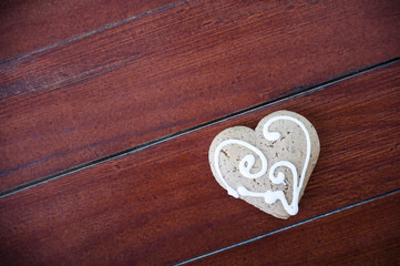 Heart shaped cookies on wooden background.