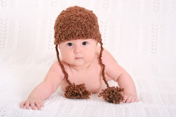 cute  baby in funny brown hat