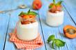 Greek yogurt with apricots in the jar.