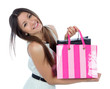Pretty young woman with shopping bags after successful shopping