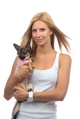 happy woman hold in hands small Chihuahua dog or puppy