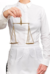 Photograph of a bust waitress holding a scale of justice