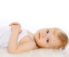 Charming child girl blonde hair on a white background, closeup p