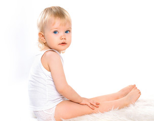 Baby girl blonde hair calm portrait