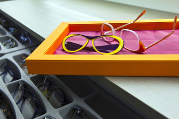 Pairs of glasses in optical shop