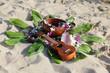 Leinwandbild Motiv Hawaiian theme arrangement on a beach