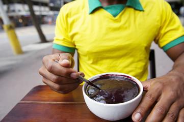 Brazilian Man Eating Bowl of Acai Açaí