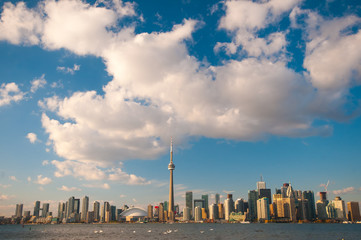 Toronto city skyline at under blue sky