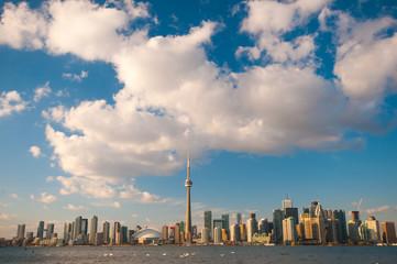 Toronto city skyline at under blue sky