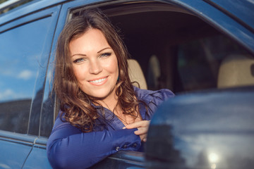 Car woman on road trip looking out of window