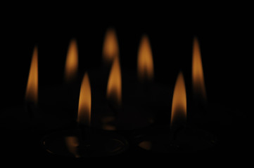 Candle flames isolated over black