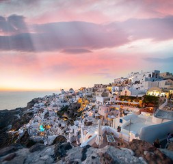 Mediterranean village of Oia at dusk, Santorini Island - Greece