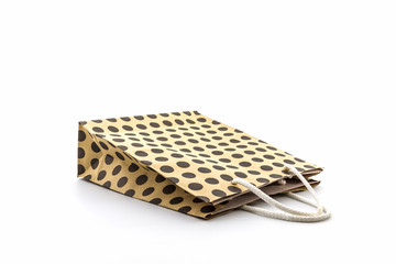 Brown polka dots paper bag.