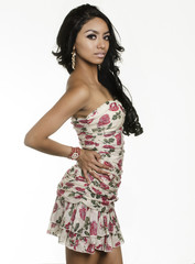 Beautiful exotic young woman wearing dress