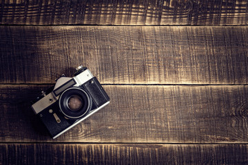 Old camera on wooden table