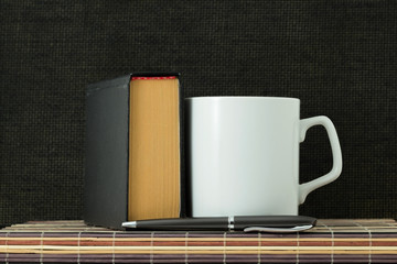 Cup, handle and book
