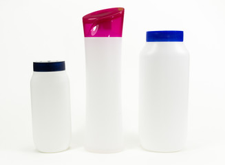 white plastic bottles on isolated white background
