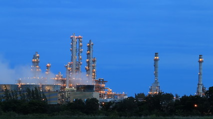 Time lapse of Industrial factory on evening with blue sky