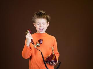 Child yelling on a retro phone.