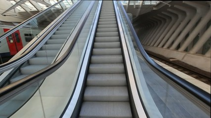 Camera moving up on escalator
