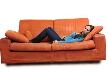 happy young woman relax on orange sofa