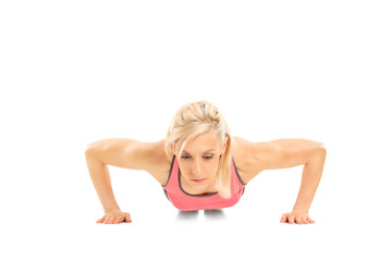 Studio shot of a female athlete doing push-ups