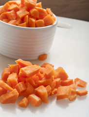 cut carrot in a bowl on white background