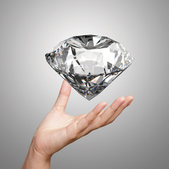 hand holding 3d diamond over white background